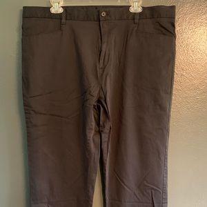 Men's Calvin Klein black pinstripe dress pants.